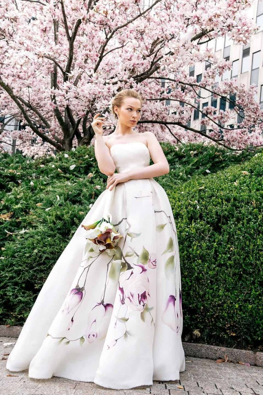 Kissing rose hand painted bridal gown with her arms folded
