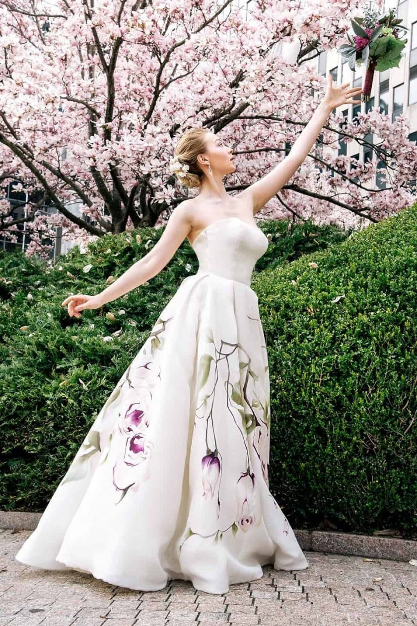 Kissing rose hand painted bridal gown tossing her bouquet