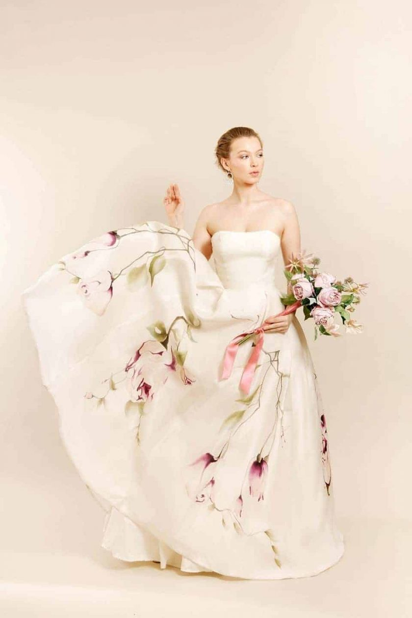 Kissing rose hand painted bridal gown being worn by model