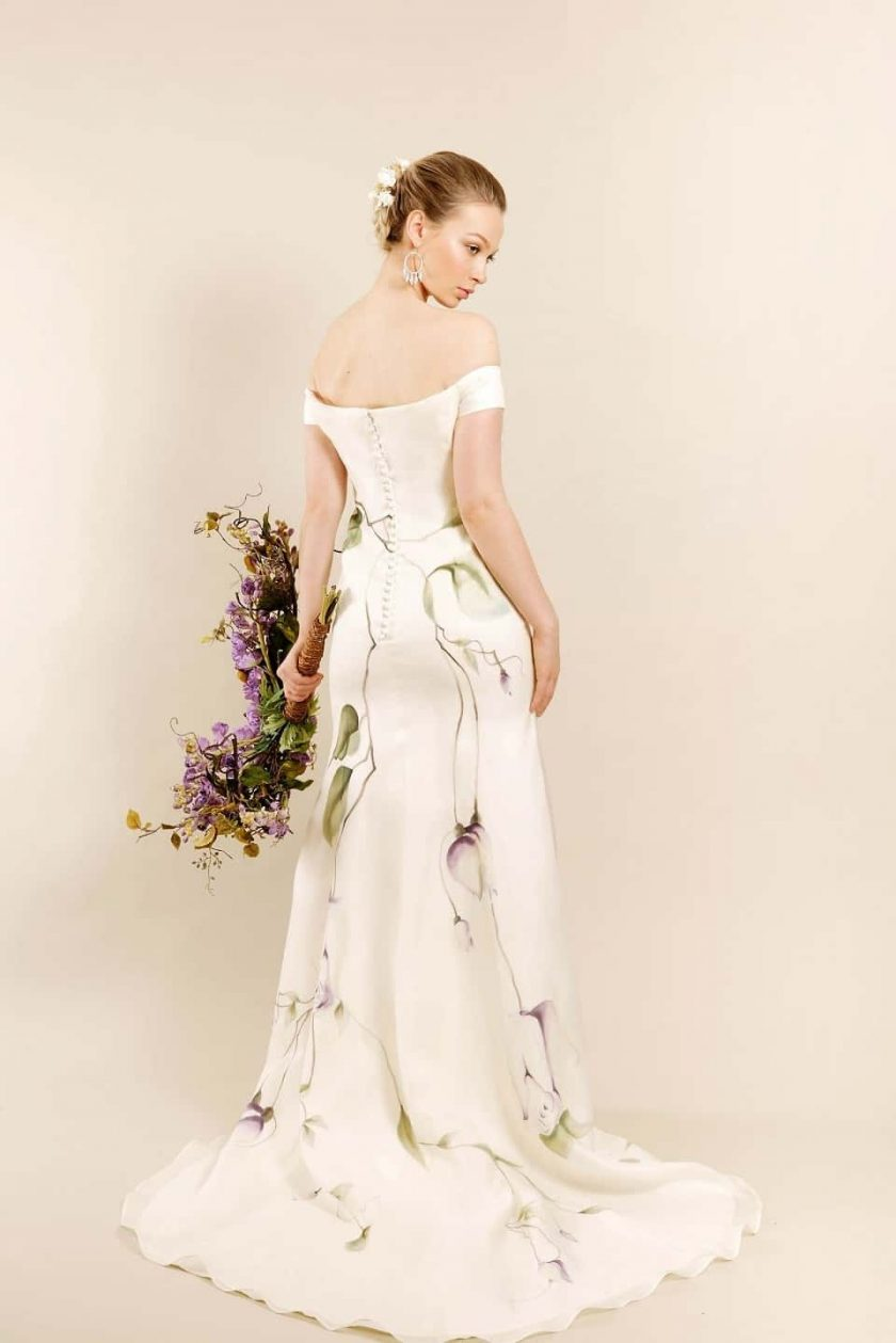 Lavender love hand painted bridal gown rear view on model with bouquet
