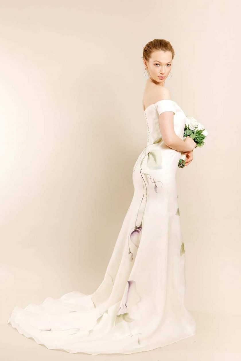 Lavender love hand painted bridal gown side view on model