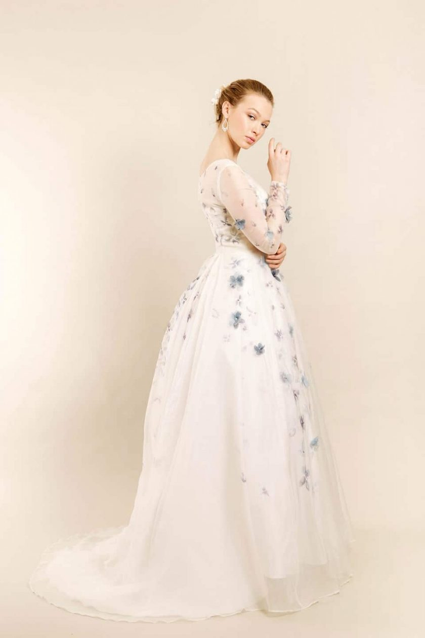 Romancing petal hand painted bridal gown side view on model