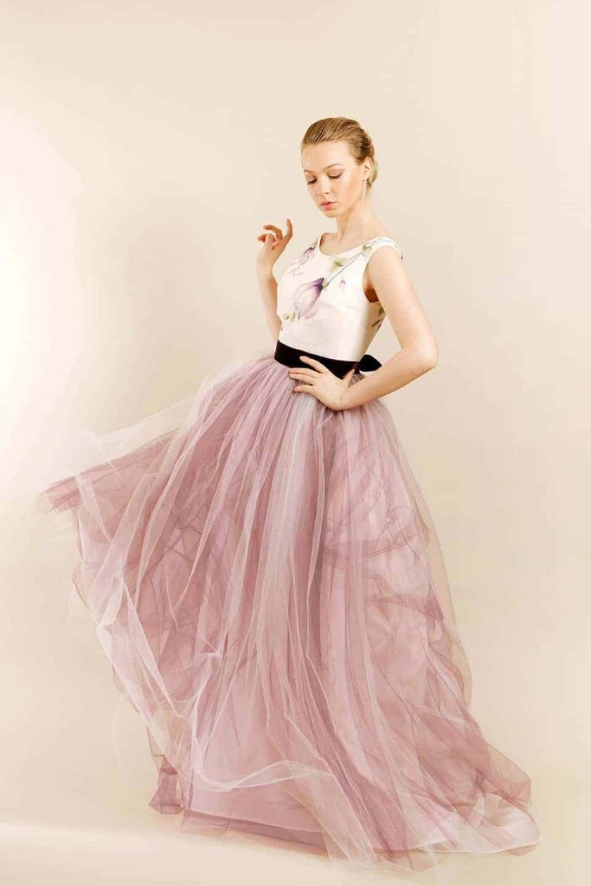 Vintage plum hand painted bridal gown with model twirling so that dress in in motion