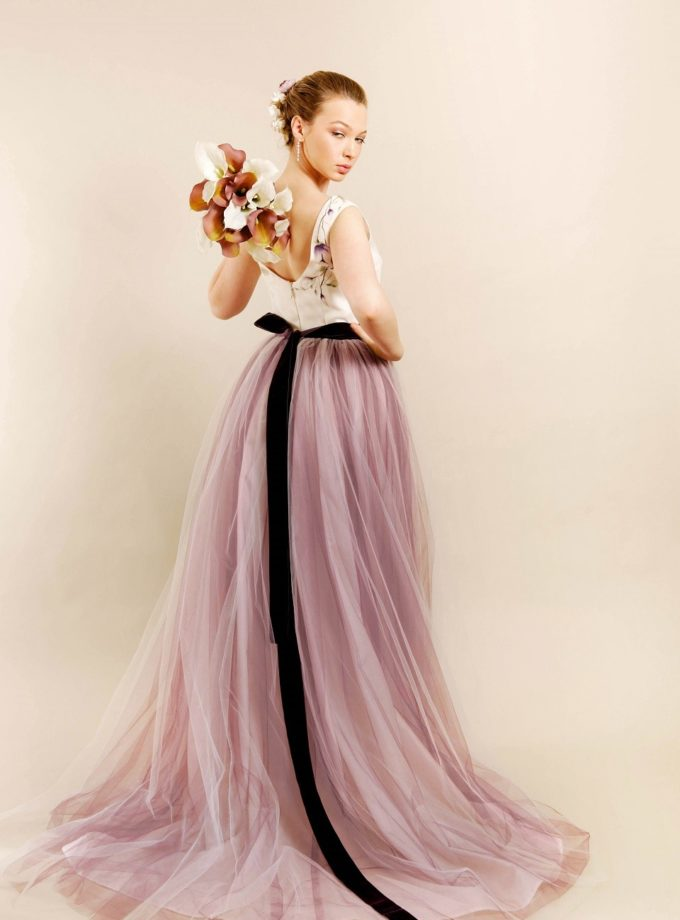 Vintage plum hand painted bridal gown rear view with model turning to look at the camera