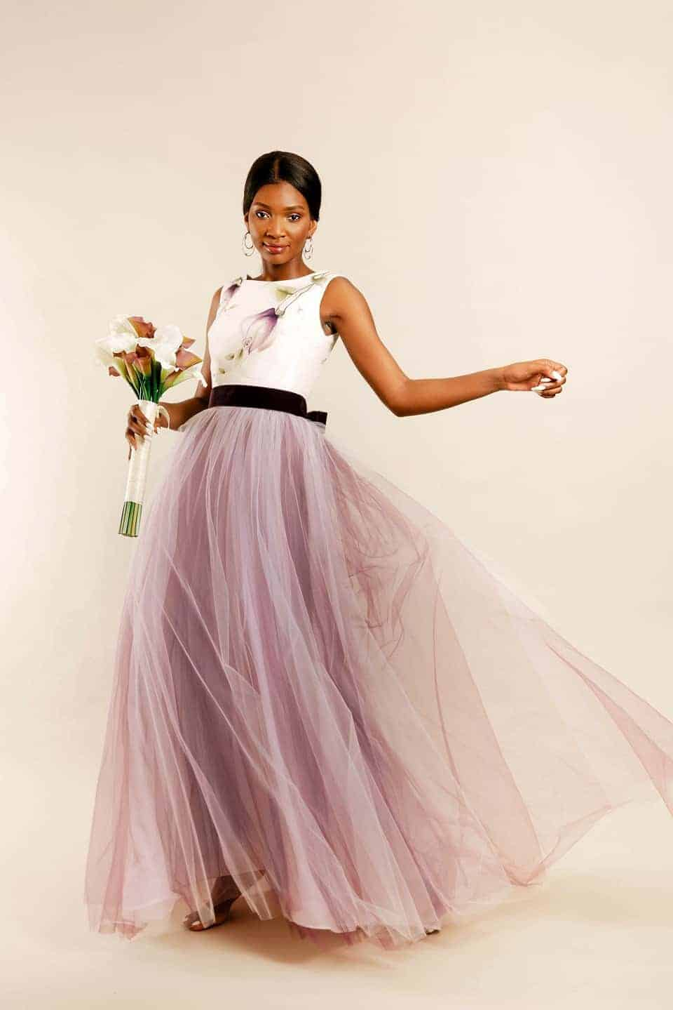 Vintage plum hand painted bridal gown with model spinning around