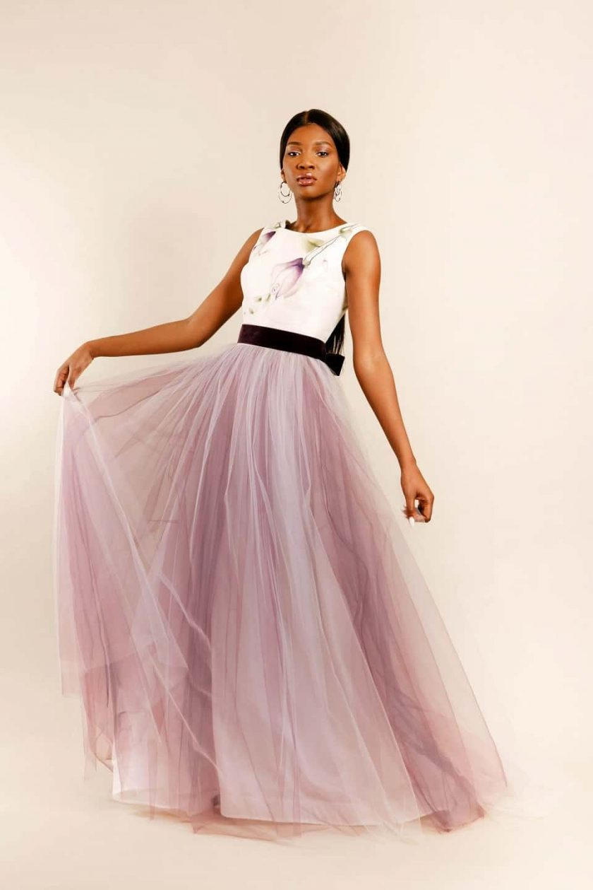 Vintage plum hand painted bridal gown with model holding up the tulle skirt