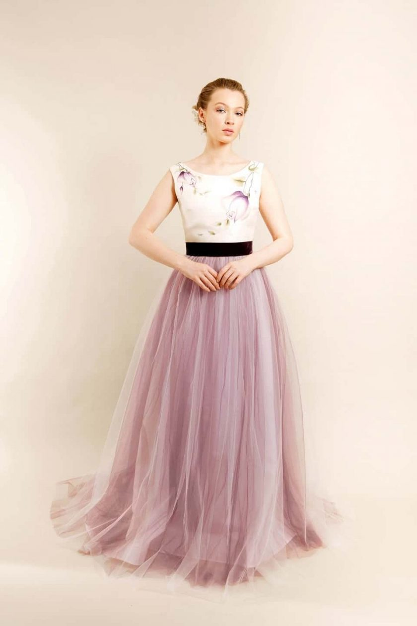 Vintage plum hand painted bridal gown model with arms in front of her